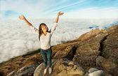 Woman on a mountain peak — Stock Photo
