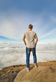 Freedom concept: man on the peak of mountain — Stock Photo