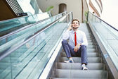 Businessman on an escalator stairs talking on mobile phone — Foto de Stock