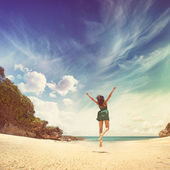 Paradise concept - woman jumping on a beach — Foto Stock