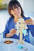 Woman making handmade x-mas tree — Stock Photo