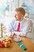 Young man on christmas eve — Stock Photo