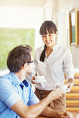 Situation in office - woman sharing tea with man — Stock Photo