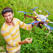 Man playing with his copter — Stock Photo