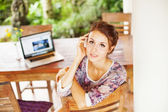 Young woman with laptop — Stock Photo