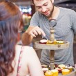 Customer chosing cupcakes — Stock Photo #48298573