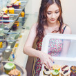 Pretty asian woman working at store — Stock Photo #48298575