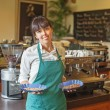 Woman working in restaurant — Stock Photo