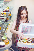 Pretty asian woman working at store — Stock Photo