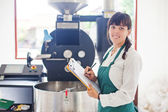 Woman working on coffee factory — Stockfoto