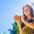 Woman drinking coconut cocktail — Stock Photo