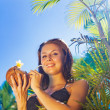 Woman drinking coconut cocktail — Stock Photo #50783481