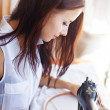Woman sewing on old sewing machine — Stock Photo #50783531
