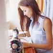 Woman sewing on old sewing machine — Stock Photo #50783537