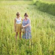 Grandmother and granddaughter on the field — Stock Photo