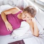 Pregnant woman reading a book — Stock Photo #50783847