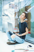 Female worker looking up, thinking — Stock Photo