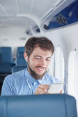 Man listen to music in airplane — Stock Photo