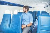 Man enjoying his journey in airplane — Foto de Stock