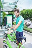 Man taking motorbike for rent — Stock Photo
