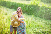 Son with his mother at the field — Stock Photo