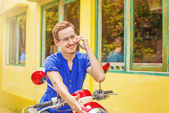 Man talking on phone on his motorbike — Stock Photo