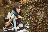 Woman on motorbike — Stock Photo