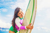 Woman holding a surf board — Stock Photo