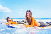 Surfer girls on boards — Stock Photo