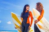 Surfer girls smiling — Zdjęcie stockowe