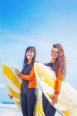 Surfer girls with boards — Stock Photo
