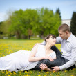 Royalty-Free Stock Photo: Girl and boy lying on the grass