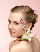 Beauty flower girl on the pink background — Stock Photo