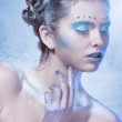 Cold winter Young woman with creative makeup — Stock Photo