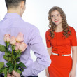 Young happy couple with pink roses — Stock Photo #21904235