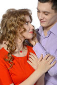 Young man gives his girlfriend a pendant — Stock Photo