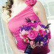 woman with bouquet of roses — Stock Photo