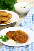 Cabbage pancakes with sour cream — Stock Photo