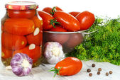 Canned tomatoes in the pot, fresh tomatoes and spices on a woode — Stock Photo