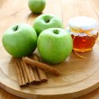 Royalty-Free Stock Photo: Green apples and honey.