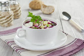 Beetroot soup with squid, cucumber and apple — Stock Photo
