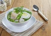 Vegetable soup with sorrel and boiled fish — Stock Photo