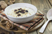 Porridge with raisins and walnuts — Stock Photo