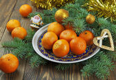 Tangerines on the holiday table — ストック写真
