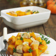 Baked pumpkin with chicken. garlic and herbs — Stock Photo