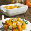 Stock Photo: Baked pumpkin with chicken. garlic and herbs