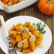 Baked pumpkin with chicken. garlic and herbs — Stock Photo #35634193