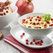 Couscous with pomegranate, raisins and spices — Stock Photo