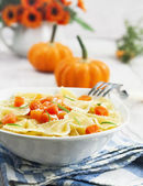 Farfalle with pumpkin and parmesan — Stock Photo