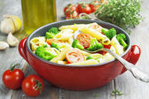 Penne pasta with broccoli and cherry tomatoes — Stock Photo